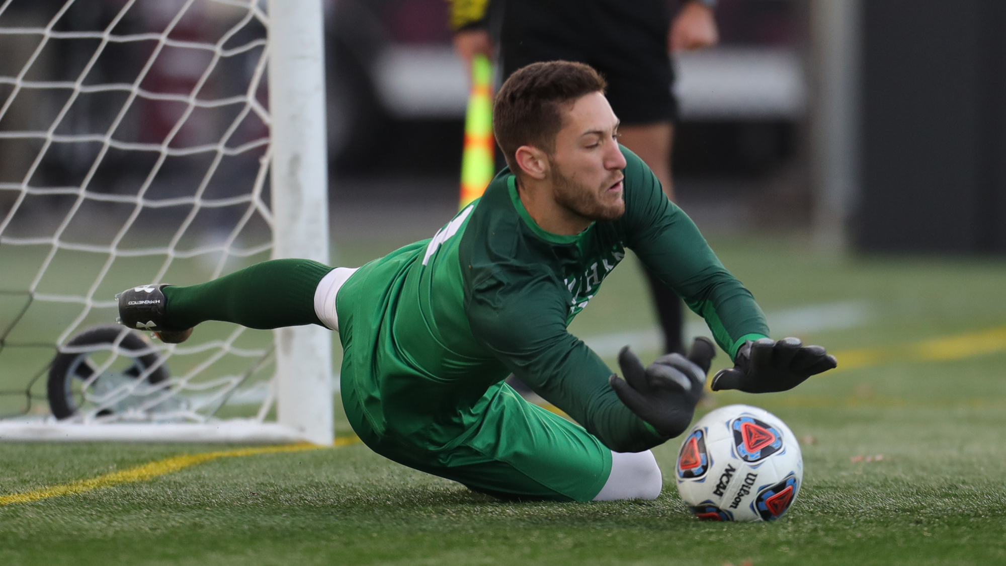 Konstantin Weis makes a save during the PK shootout vs. URI
