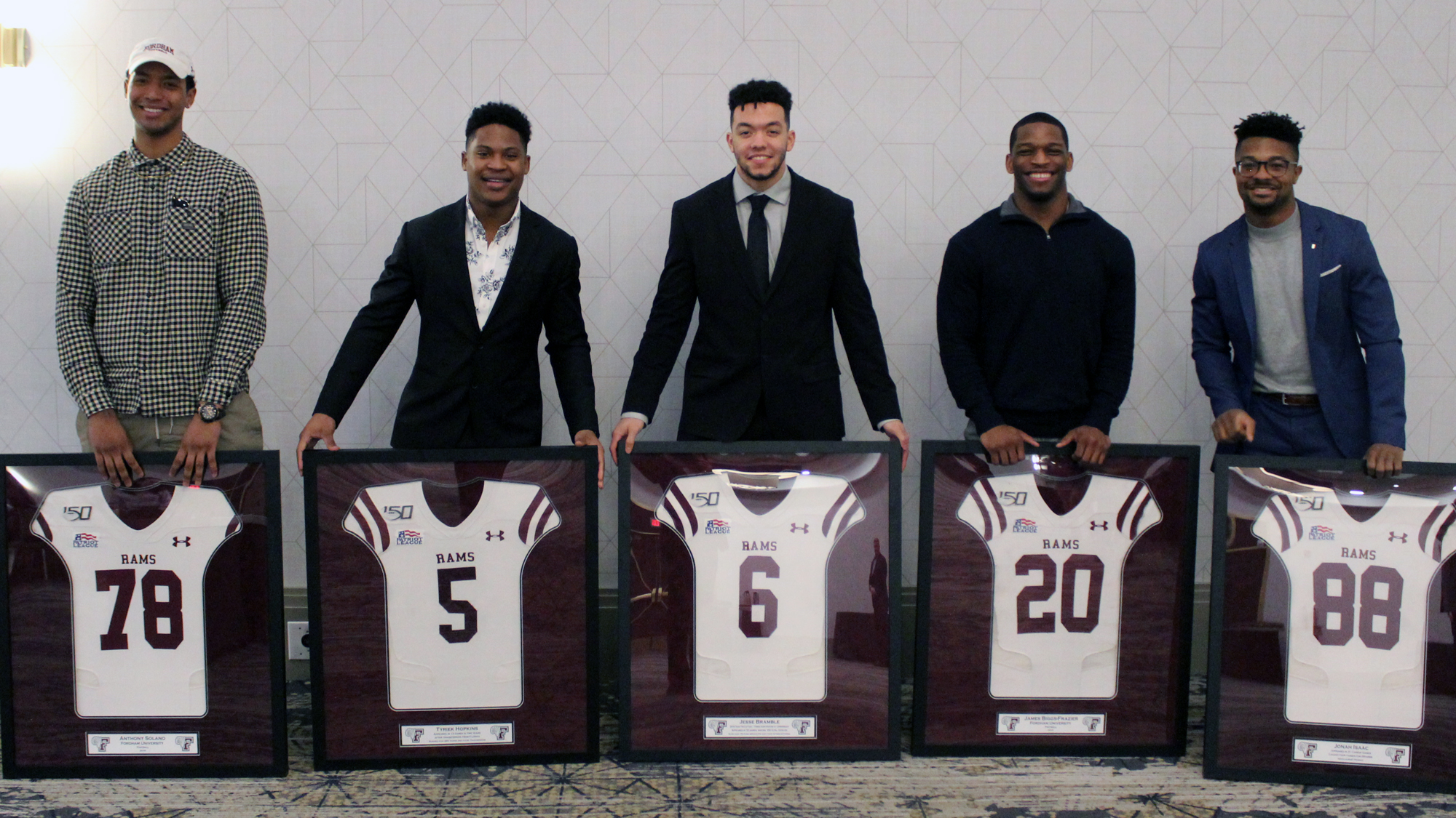 The 2019 Fordham seniors with their framed jerseys