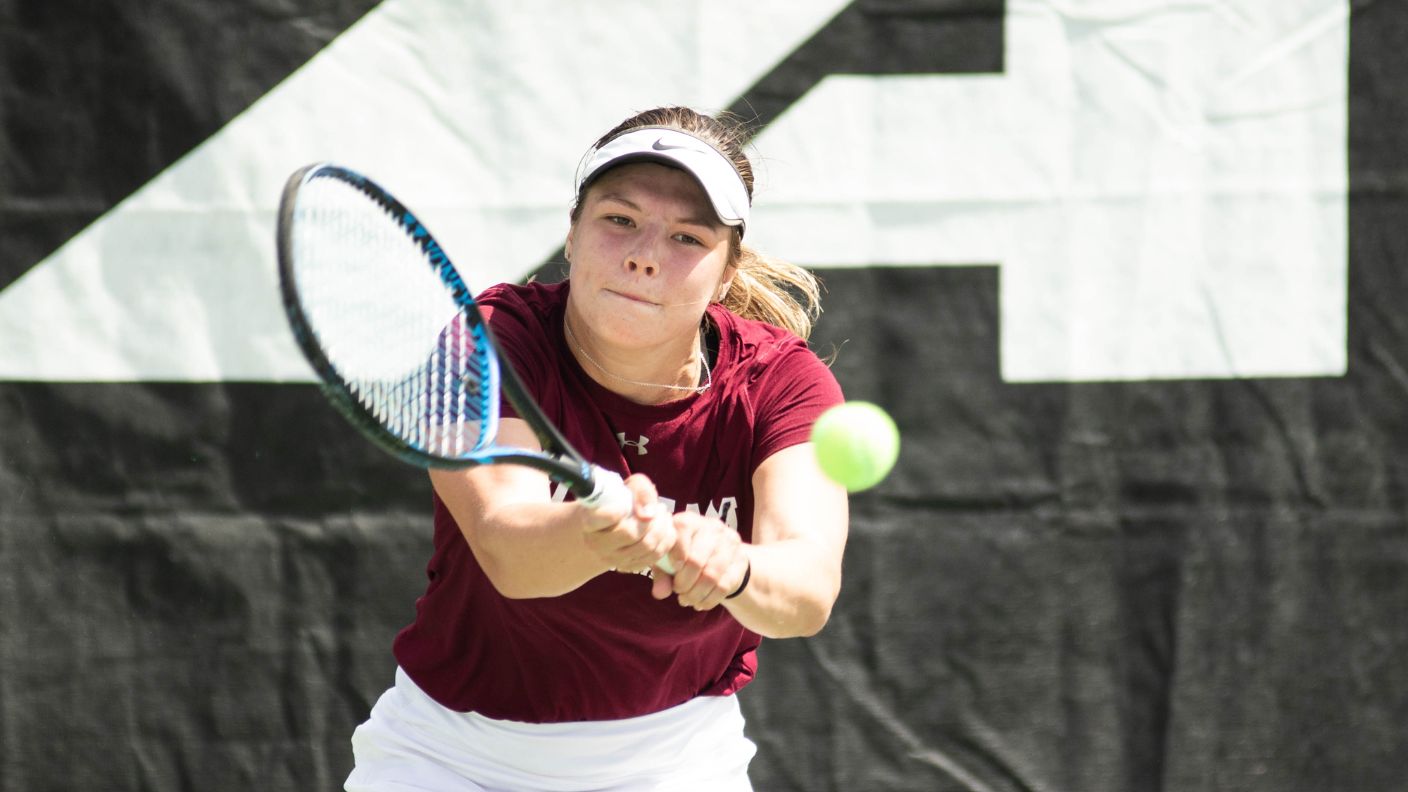 Genevieve Quenville hits a forehand